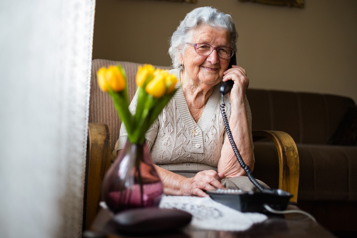 Happy older woman on phone.jpg