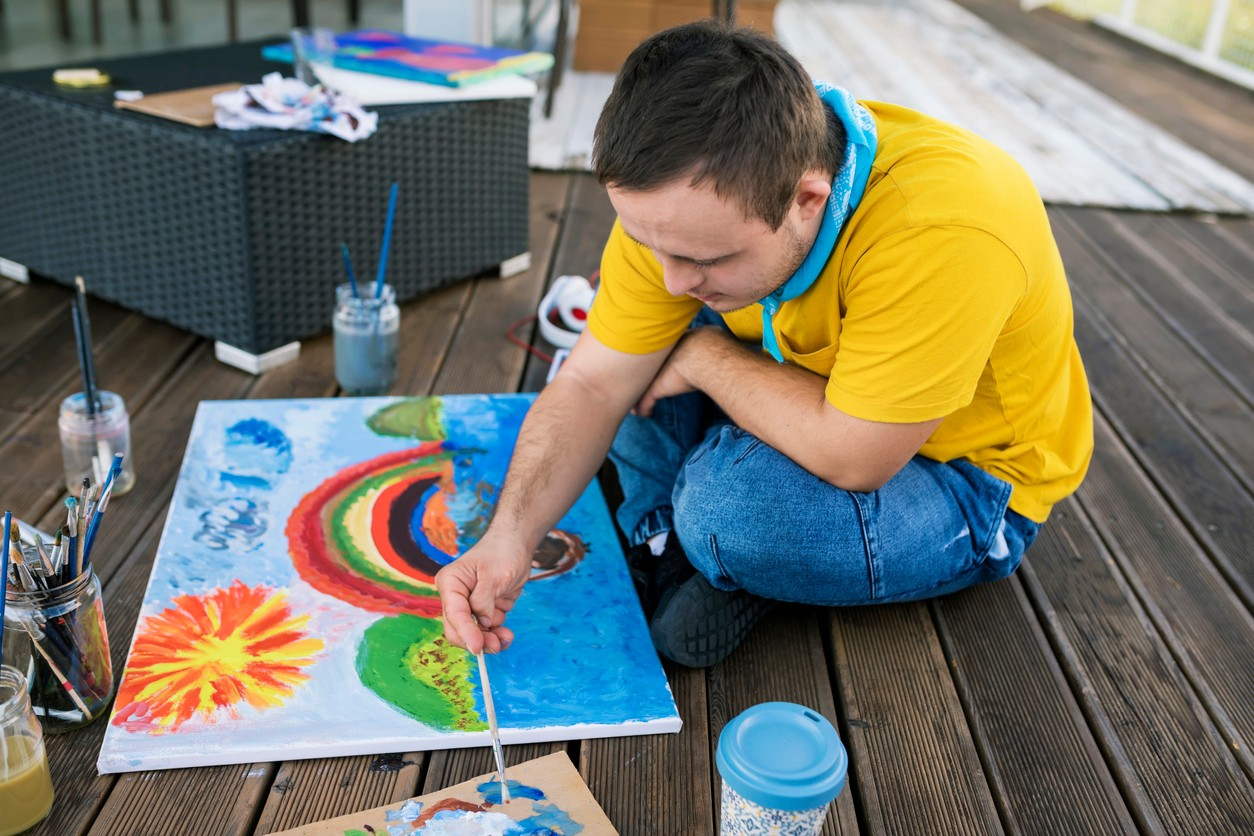 Young man painting.jpg